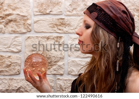 Side view of a pretty female fortune teller
