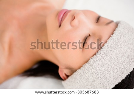 Side view of a relaxed woman lying on the massage table at the health spa