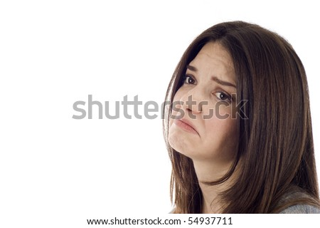 Side view of a sad woman isolated over white background, a lot of copyspace.