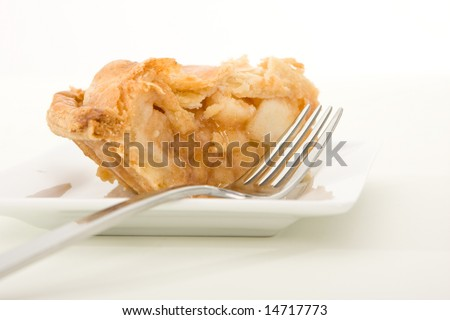 Side view of a slice of apple pie ready to be eaten.