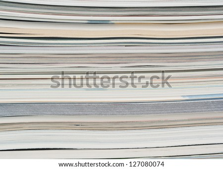Side view of a stack of paper, books and magazines. - stock photo
