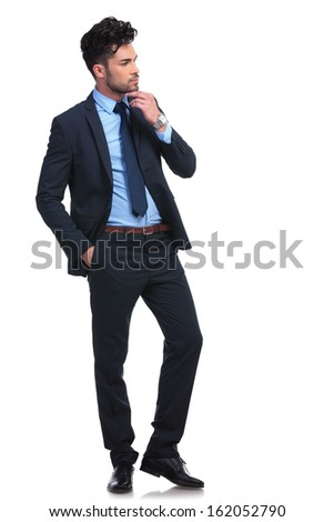 side view of a thoughtful young business man looking to his side - stock photo