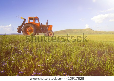 Side View Of A Tractor In A Scenic View Concept