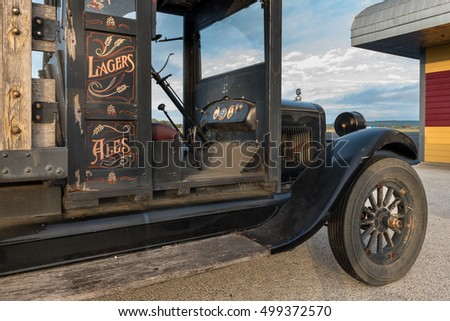 Side view of a vintage 1926 truck with a wooden bed shot at sunrise