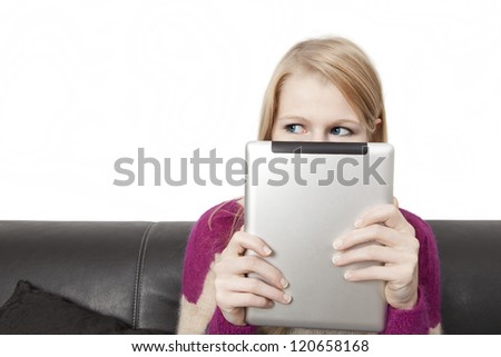Side view of a woman holding a tablet PC in front of her face