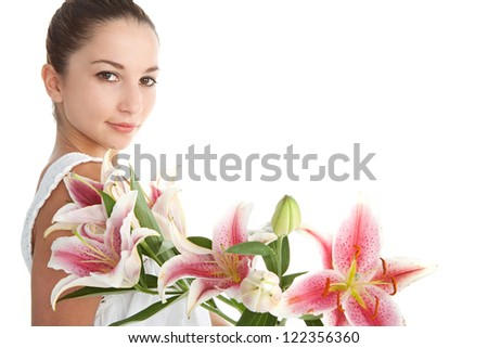 Side view of a young beautiful woman with pink japanese lily flowers, isolated on a white background. - stock photo