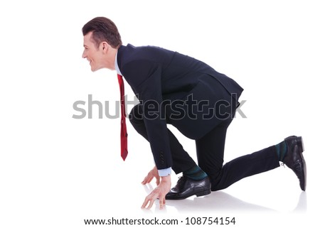 side view of a young business man at the start of the race on white background - stock photo