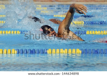 Side view of a young male swimmers in pool - stock photo