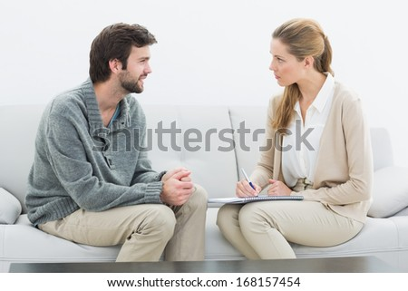 Side view of a young man in meeting with a financial adviser at home