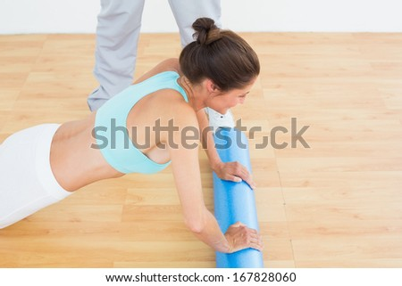 Side view of a young woman do push ups in the gym at hospital - stock photo