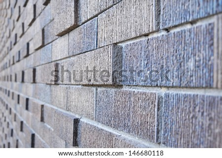 Side view of abstract brick wall - background - stock photo