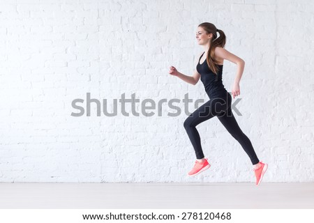 Side view of active sporty young running woman runner athlete with copy space concept sport health fitness loss weight cardio training jog workout wellness. - stock photo