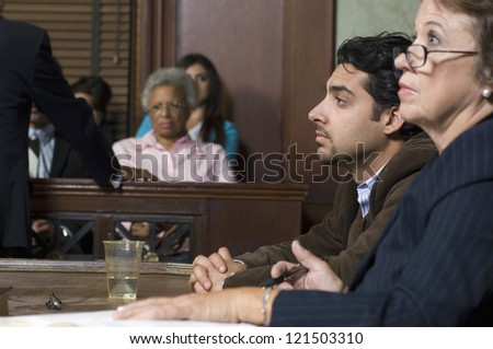 Side view of advocates with client during prosecution in court house - stock photo
