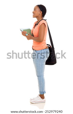 side view of african american college girl looking up - stock photo