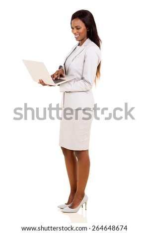 side view of african business executive using laptop