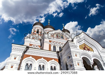 Side view of Alexander Nevsky Cathedral which is the grandest orthodoxy capula cathedral of Tallinn, on cloudy sky background. - stock photo