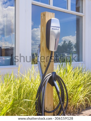 Side view of an electric car charging station. - stock photo