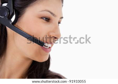 Side view of angry call center agent against a white background - stock photo