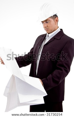 side view of architect looking the blueprint on white background - stock photo