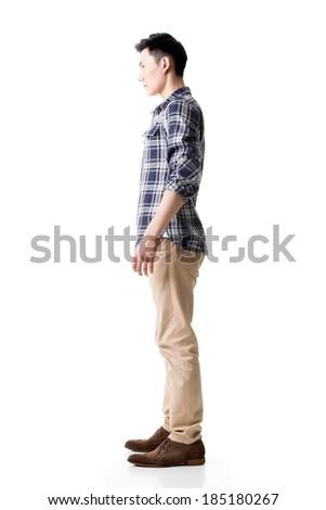 Side view of Asian young man, full length portrait isolated on white.
