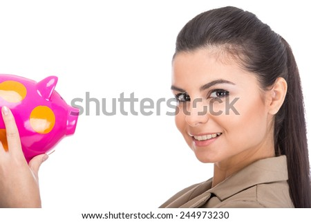 Side view of attractive young woman with moneybox isolated on a white background. - stock photo