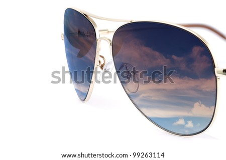 Side view of aviator woman sun glasses with sky reflection isolated on white background. - stock photo