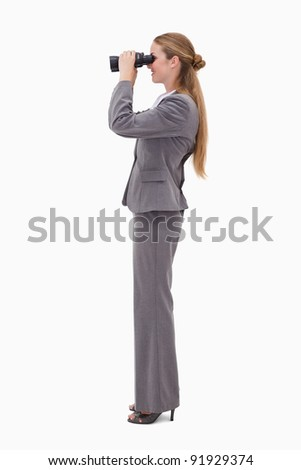 Side view of bank employee using spyglasses against a white background - stock photo