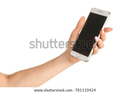 Side view of beautiful relaxed left human female hand with neutral manicure hold blank screen smartphone in a palm isolated on abstract blurred white background. Detailed closeup studio shot