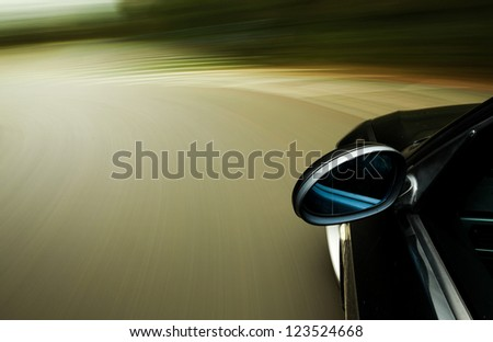 Side view of black car with heavy blurred motion - stock photo