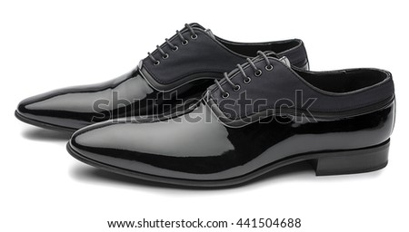 Side view of   black patent leather men shoes isolated on white background.         - stock photo