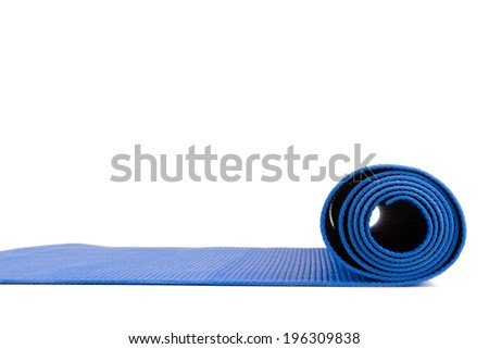 Side view of blue open yoga mat for exercise, isolated on white background. - stock photo
