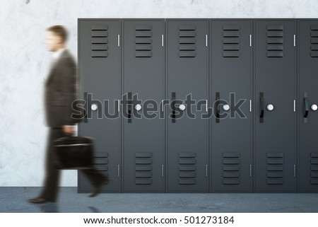Side view of blurry businessman walking in school corridor with grey lockers. 3D Rendering