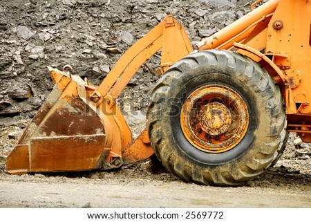 side view of bulldozer scoop and tire