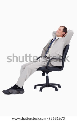 Side view of businessman leaning back in his chair against a white background - stock photo