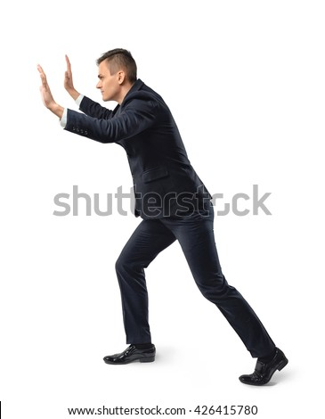Side view of businessman pushing something heavy, isolated on white background. New future. Thriving society. Digital presentation. Business staff. Digital tablet. Business concept.