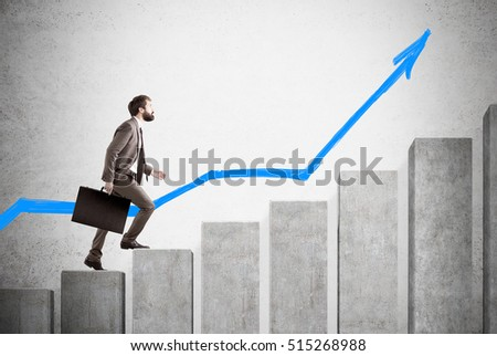Side view of businessman with a suitcase climbing concrete graph with a blue arrow in the background. Concept of growth. Mock up