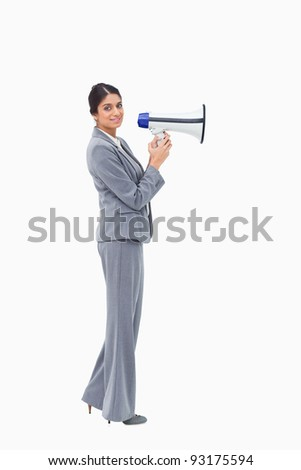 Side view of businesswoman with megaphone against a white background