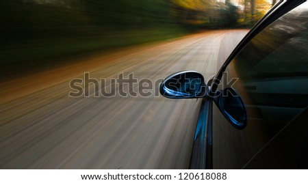 Side view of car with blurred motion - stock photo