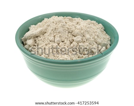 Side view of caramel cake mix dry ingredients in a bowl isolated on a white background. - stock photo