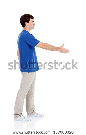 side view of casual young man handshake - stock photo
