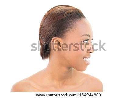 Side view of cheerful pretty woman on white background