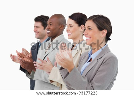 Side view of clapping salesteam standing together against a white background