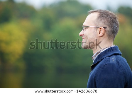 Side view of confident mature man smiling - stock photo
