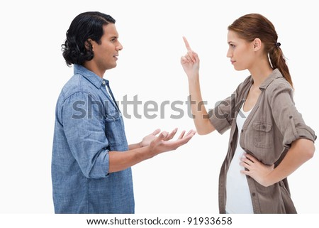 Side view of couple in a tensed conversation against a white background - stock photo