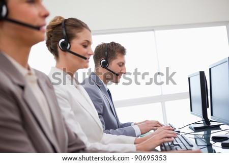 Side view of customer advisory service at work - stock photo
