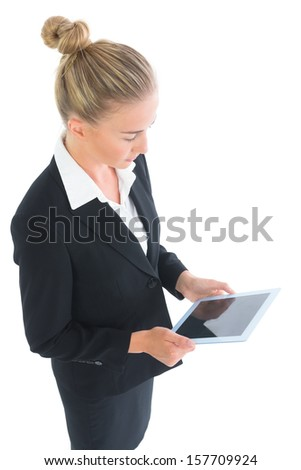 Side view of cute businesswoman working with her tablet on white background