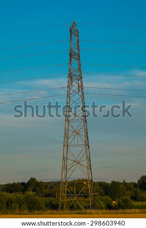 side view of electricity pylon in rural setting
