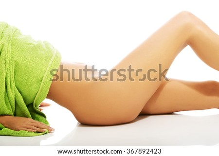 Side view of female nude slim legs