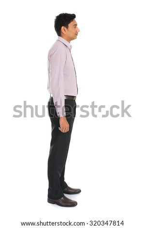 side view of formal indian business man with white background - stock photo
