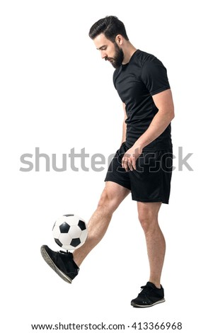 Side view of freestyle soccer or futsal player juggling ball with his legs. Full body length portrait isolated over white background.  - stock photo